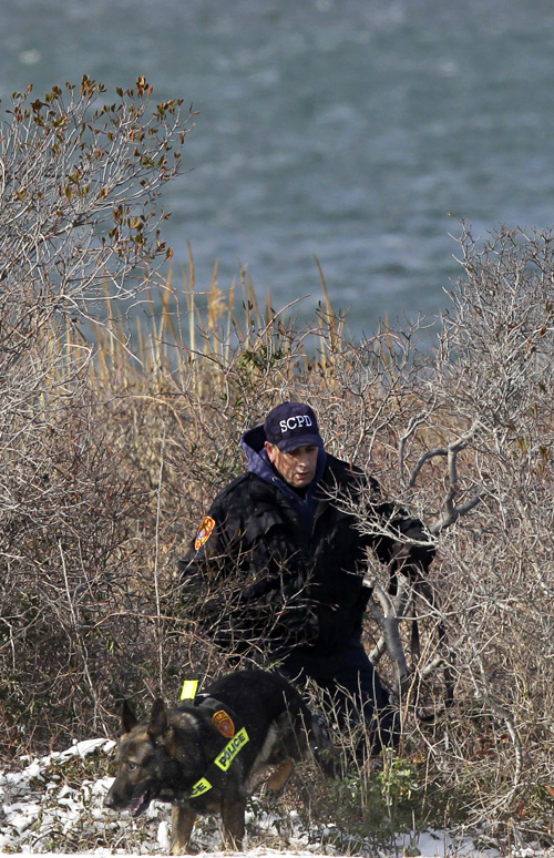 Police search the narrow strip of land on Long Island, N.Y., that divides the Great South Bay from the Atlantic Ocean. A four-lane parkway runs through the middle, connecting Jones Beach State Park with several state and town-run beaches to its east.