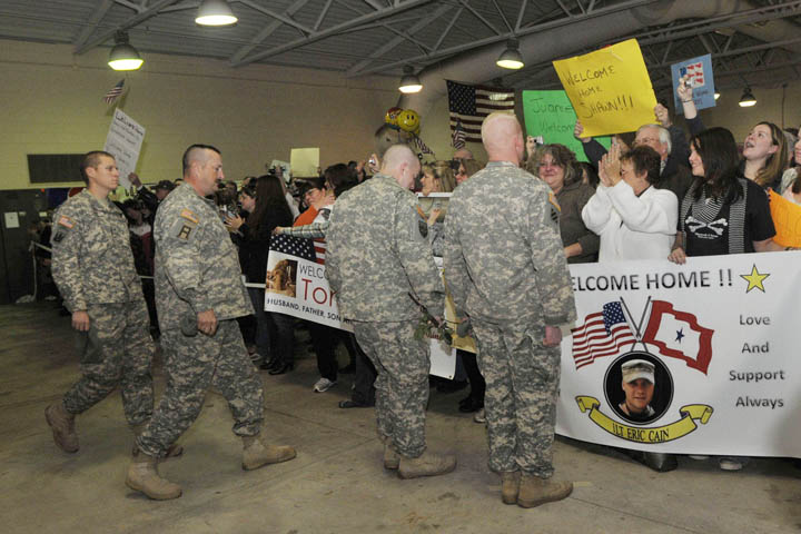 Members of the Maine Army National Guard's Bravo Company 172nd Mountain Infantry are greeted by family and friends as they enter the Air Force Reserve Center in Bangor today.