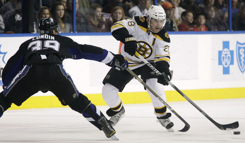 GAME-WINNER: Boston Bruins left wing Mark Recchi scored the game-winning goal with 19.7 seconds left as the Bruins beat the Tampa Bay Lightning 4-3 on Tuesday night in Tampa, Fla.