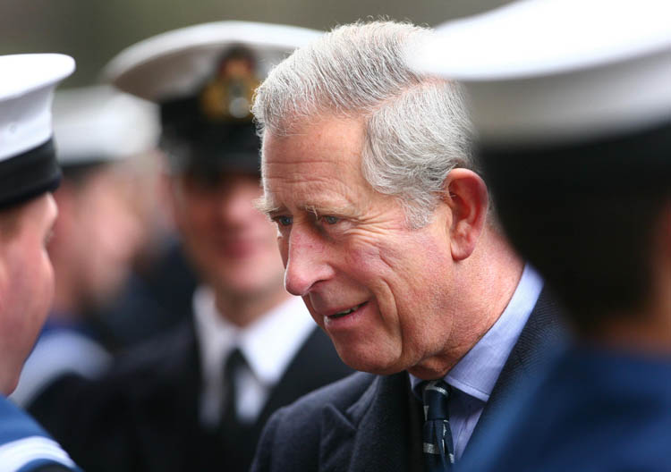 The Prince of Wales talks to navy personnel in London today as he presents operational medals for service in Afghanistan.