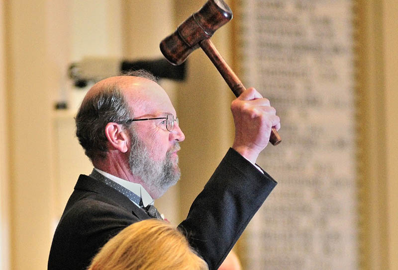 Rep. Robert Nutting, R-Oakland, holds up the gavel after being elected Speaker of the House on the first day of the 125 Legislature this morning at the State House in Augusta.