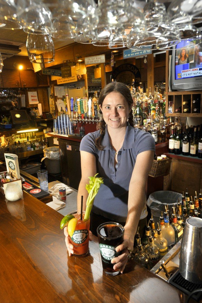 Bartender Jocelyn Harriman serves up drinks. Jameso's fiercely local tap selection rotates frequently.