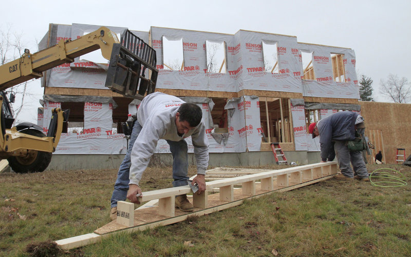 Builders nail together a roof panel for a home under construction in Derry, N.H. Weak housing sales mean fewer jobs in the construction industry, a sector that normally powers economic recoveries.