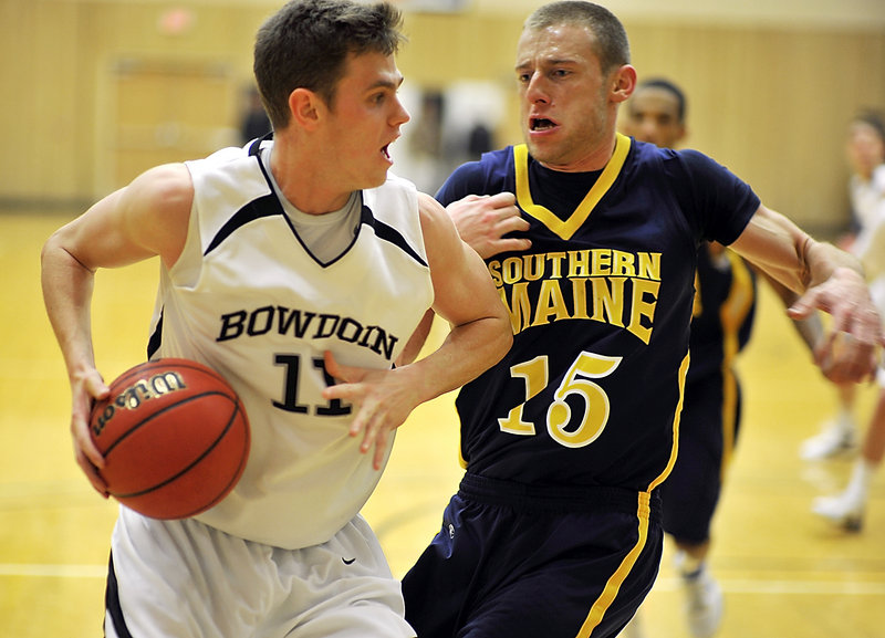 Will Hanley of Bowdoin looks for room while guarded by USM's Leif O'Connell. Hanley, a 6-foot-7 junior, led the Polar Bears with 18 points.