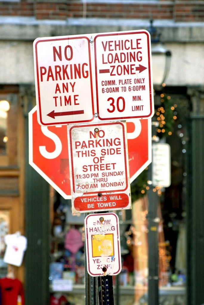 Signs in Portland show that parking can indeed be a problematic issue downtown.
