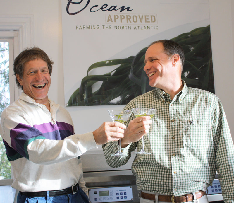 Ocean Approved owners Tollef Olson and Paul Dobbins toast with mock-ups of their