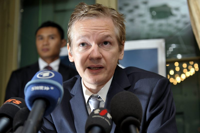Wikileaks founder Julian Assange, seen at the Geneva Press Club on Nov. 4, has not made a public appearance in a month. He is now sought for questioning in an alleged rape case, an effort that his lawyer claims is retaliation for the ongoing release of diplomatic documents.