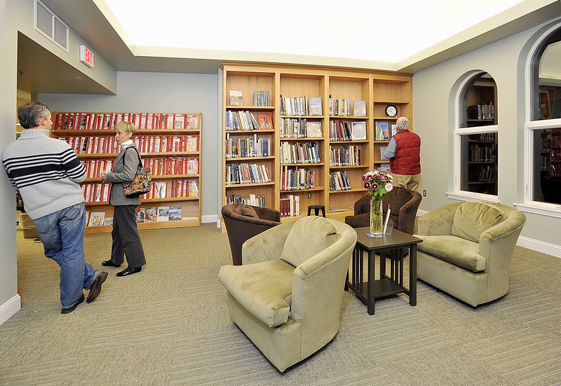 """Visitors explore the new Henrietta Carroll Room at Thursday's grand opening of the McArthur Library renovations. Carroll, a past library trustee, """"would have loved this,"""" said her granddaughter Abigail Carroll."""