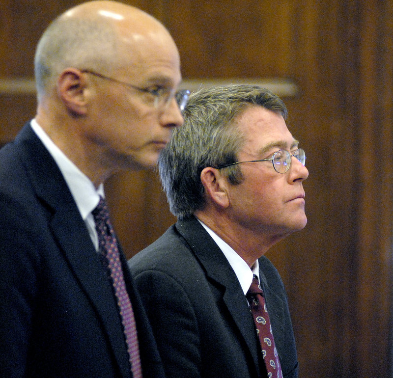 John D. Duncan, at right, stands with his attorney, Toby Dilworth, as he is sentenced in September 2008 in Cumberland County Superior Court in Portland for stealing almost $300,000 from clients and his former law firm, Verrill Dana.