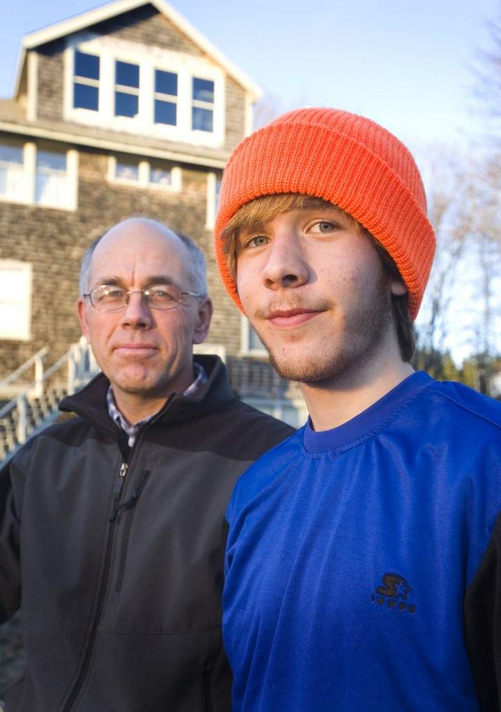 Charlie Jones, a senior, trains with his father, Ken, left, a teacher and coach at the school.