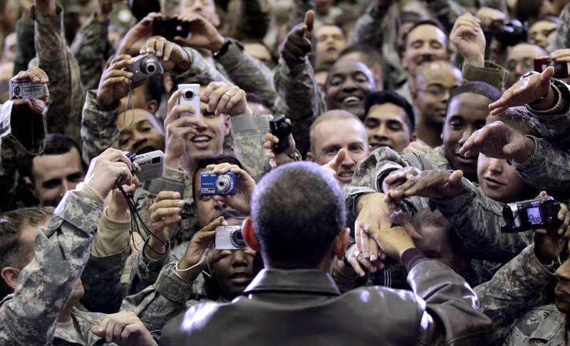 President Obama greets military personnel at a rally during a surprise visit Friday at Bagram Air Force Base in Afghanistan. He told troops they're breaking the Taliban's momentum.