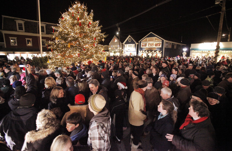 People crowd Dock Square in Kennebunkport for a tree lighting ceremony during Christmas Prelude on Friday. This weekend is the start of the town's 29th annual Christmas Prelude, which runs through next weekend.