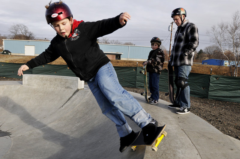 """Nate Hanson, 8, of Freeport works on his skills at the skatepark on a visit there with his father, Kris Hanson, and friend, Vito LaVopa. """"This is our thing. It's something we do together,"""" said Kris."""