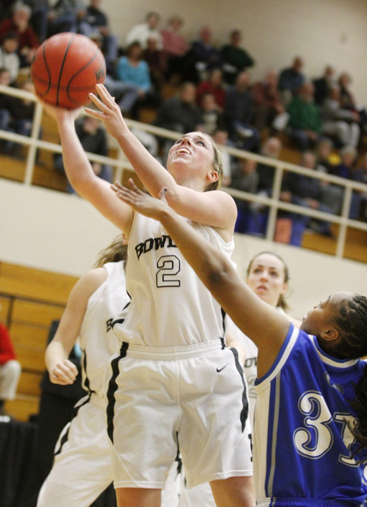 Kaitlin Donahoe of Bowdoin shoots over Colby's Jayde Bennett during the first half of Saturday's game at Brunswick. Donahoe had 16 points in Bowdoin's 70-64 victory.