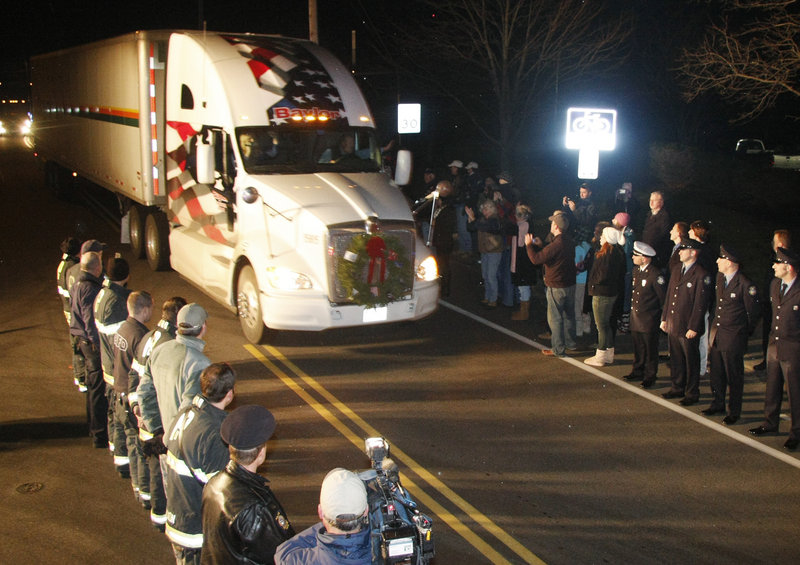 Members of the Portland police and fire departments line Ocean Avenue as the Wreaths Across America convoy arrives at Cheverus High School on Sunday.
