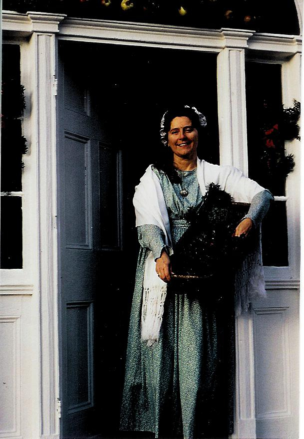 Betsey-Ann Golon, seen here in period dress, and her husband, Dale, own Common Folk Farm in Naples.