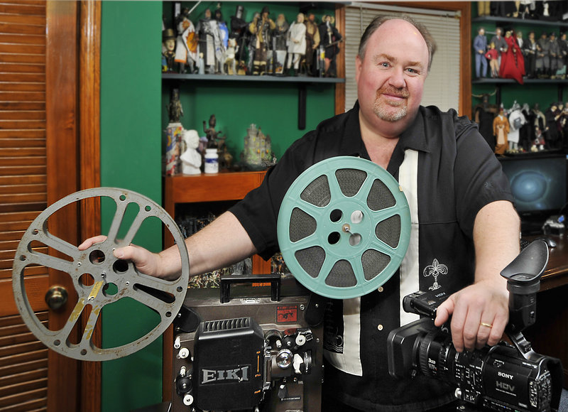 Reggie Groff of Falmouth transfers old films to digital format by screening films on his old Eiki projector and recording it on a high-resolution video camera. He says orders to transfer old family films to DVDs increase during the holiday season.