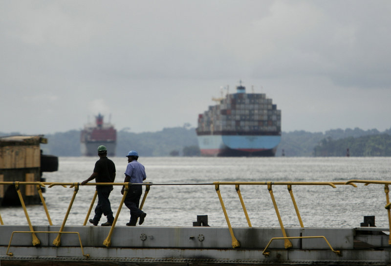 Two Panama Canal workers walk over water gates in Gatun Lock. The canal was among several key shipping channels identified in U.S. State Department cables as among hundreds of potential targets for terrorist attacks. The list of targets is among secret documents released in recent days by the WikiLeaks website.