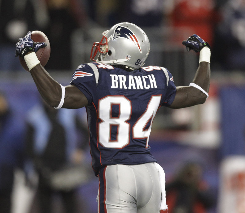 Deion Branch celebrates after scoring a touchdown against the New York Jets. The Patriots trounced the Jets 45-3 Monday in a showdown between two of the best teams in the AFC. Branch had three catches, while Tom Brady threw for 326 yards and four touchdowns.