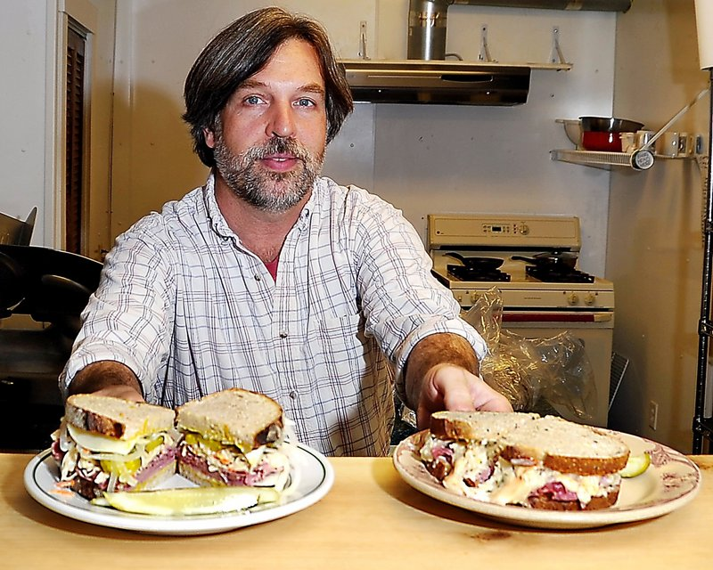 Owner Sumner Richards serves up a a Hard Luck Johnny, left, and a Corned Beef and Cabbage Reuben.