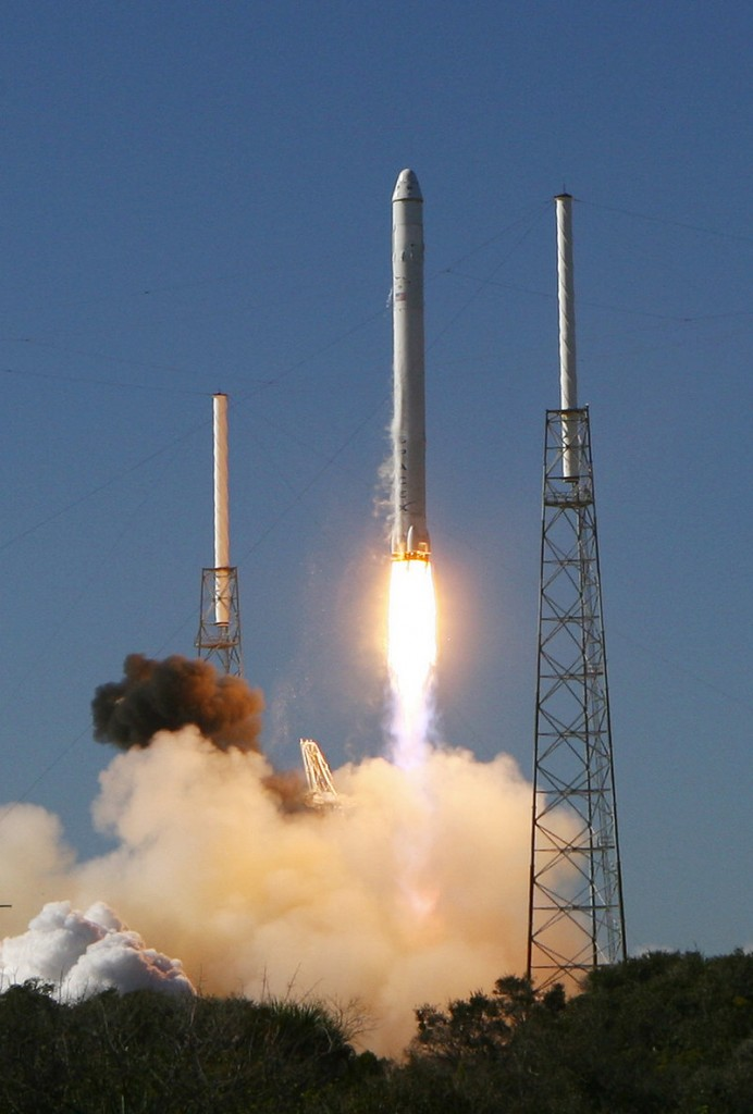A Falcon 9 rocket built by SpaceX blasts off from Cape Canaveral, Fla., carrying an unmanned Dragon capsule 187 miles into space orbit.