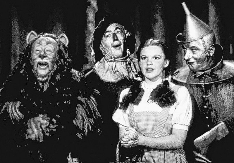 "The ""Oz"" cast, from left: Bert Lahr as the Cowardly Lion, Ray Bolger as the Scarecrow, Judy Garland as Dorothy, and Jack Haley as the Tin Woodman."