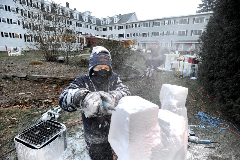 Ice sculptor Ed Jarrett carves a lobster from a block of ice for the Fire & Ice Bar fundraiser on Friday.