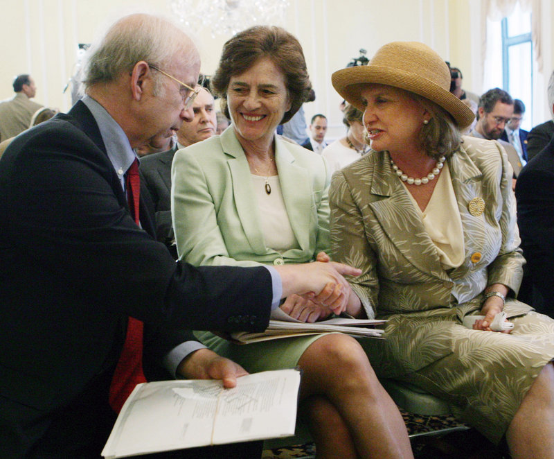 """Allen Weinstein, archivist of the United States, greets Rep. Carolyn Maloney, D-N.Y., right, as former U.S. Rep. Elizabeth Holtzman looks on during a 2006 press briefing. The women championed the Nazi War Crimes Disclosure Act of 1998, which revealed a """"difficult, and in some respects shameful, chapter of American history."""""""