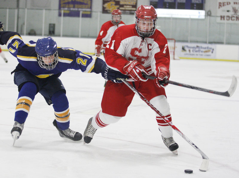 Defenseman Tommy Ellis, right, is part of an experienced South Portland squad looking to build on last year's success.