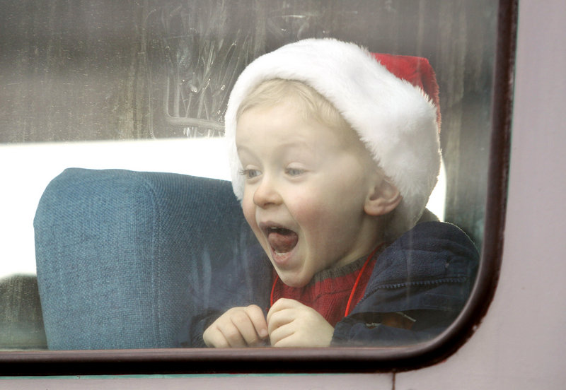 Jack Burnham, 5, of Norway shows his excitement as the Candy Cane Train prepares to leave Bath on Saturday.
