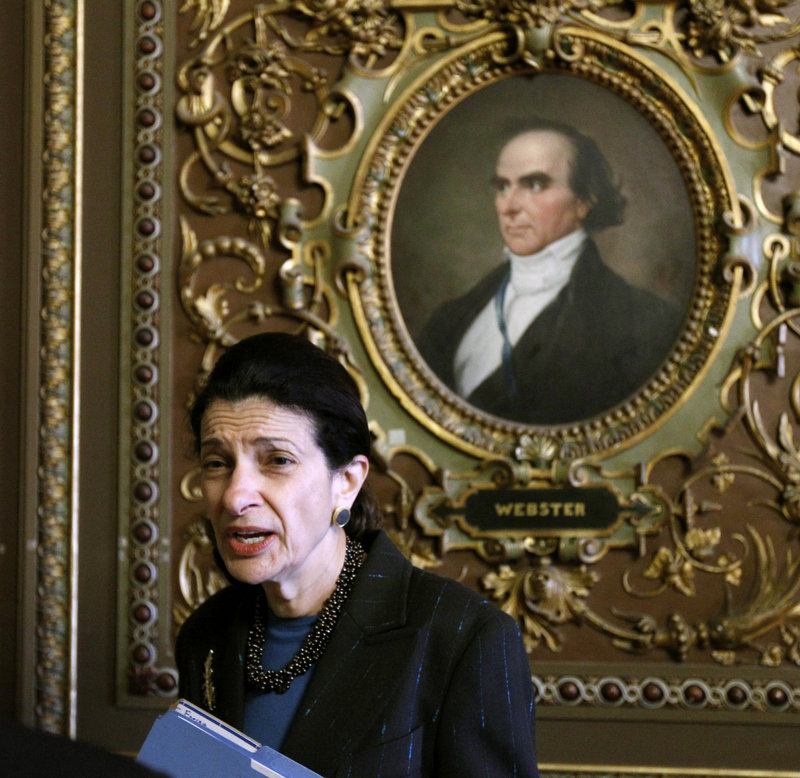 Sen. Olympia Snowe, R-Maine, talks with a reporter during a procedural vote Monday on President Obama's tax-cut bill. She voted in favor of the package.