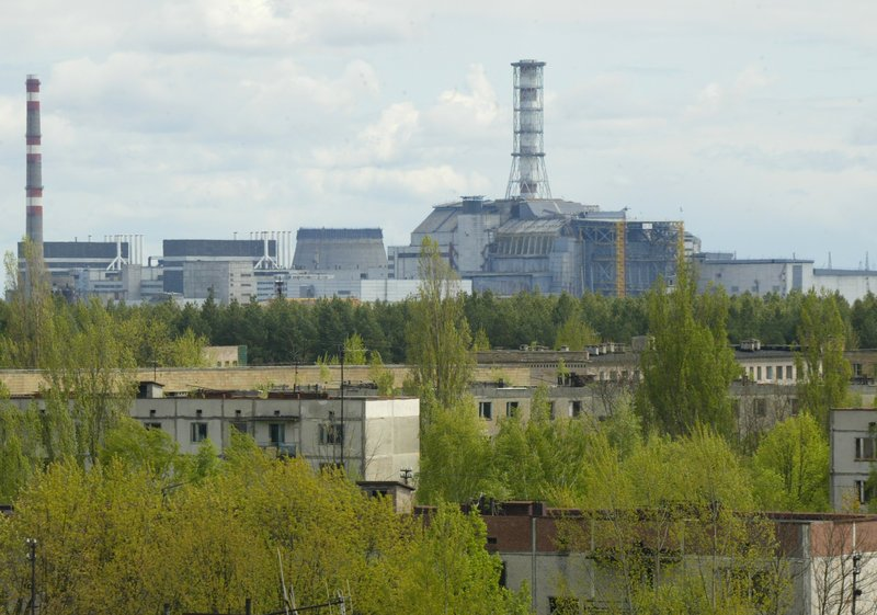 The Chernobyl nuclear power plant looms over empty houses in the town of Pripyat, Ukraine. Next year, the government will open the contaminated zone around the reactor to visitors who want to learn more about the nuclear tragedy that occurred there in 1986.