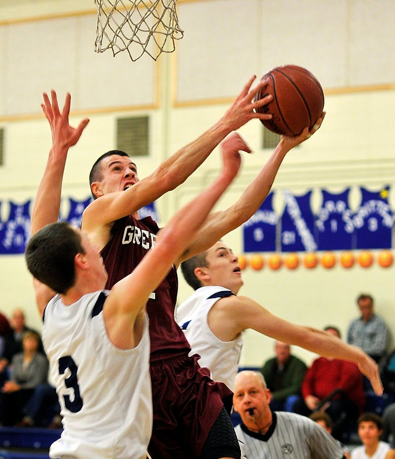 Sam Johnston, who led a balanced Greely attack with 12 points, drives to the basket against Yarmouth defenders Josh Britten, left, and Sam Torres. The visiting Rangers improved to 2-0, while cold-shooting Yarmouth fell to 1-1.