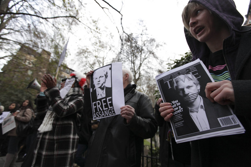 Protesters show support for Julian Assange outside Westminster Magistrates Court in London on Tuesday. The WikiLeaks founder appeared in a London court, seeking to fight his extradition to Sweden in a sex-crimes investigation.