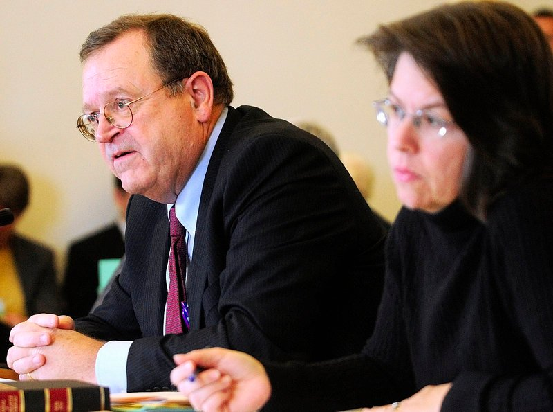 Secretary of the Senate Joseph G. Carleton Jr., left, and Clerk of the House Heather J.R. Priest meet with the Rules Committee on Wednesday at the State House in Augusta.