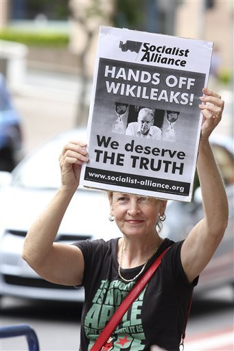 A protester in Brisbane, Australia, holds a poster Dec. 10 decrying the arrest of WikiLeaks founder Julian Assange.