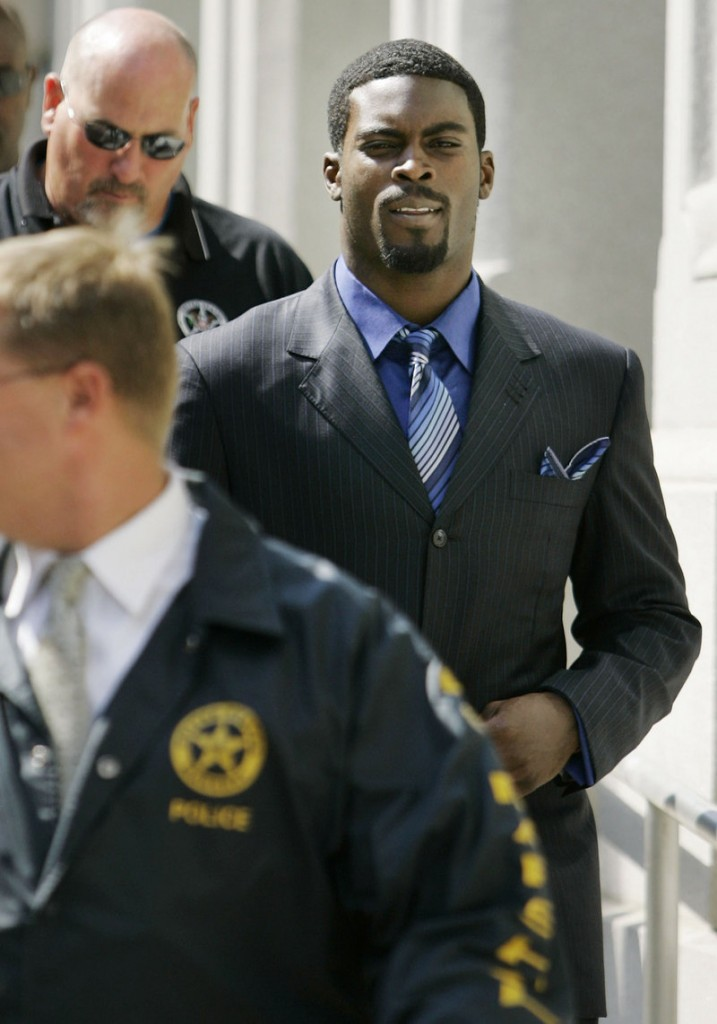 Michael Vick, right, who served 18 months in prison on dogfighting charges, is not allowed to own a dog until his probation ends in May 2012.