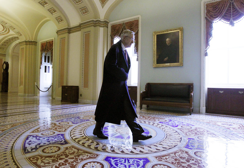 Senate Majority Leader Harry Reid, D-Nev., walks to his Capitol Hill office on Friday. Democrats say Republican obstructionism has led to the current lame-duck session.