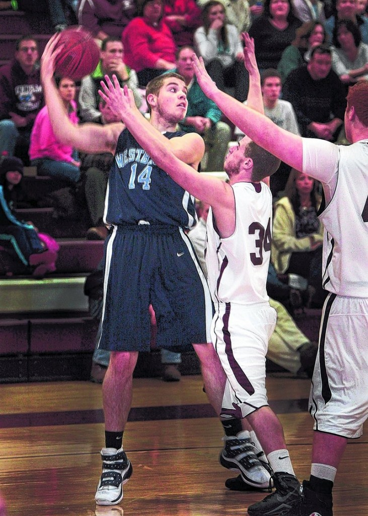 Sean Murphy, who scored 30 points Friday night for Westbrook, including 21 in the opening quarter, looks to pass as Kyle Williams of Windham defends in the third quarter of Westbrook s 61-50 victory at Windham.