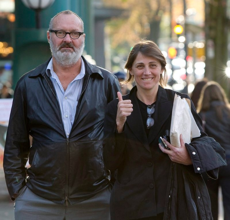 Randy Quaid and his wife, Evi, are shown outside their lawyer's office in Vancouver. She has failed again to appear in court in California.