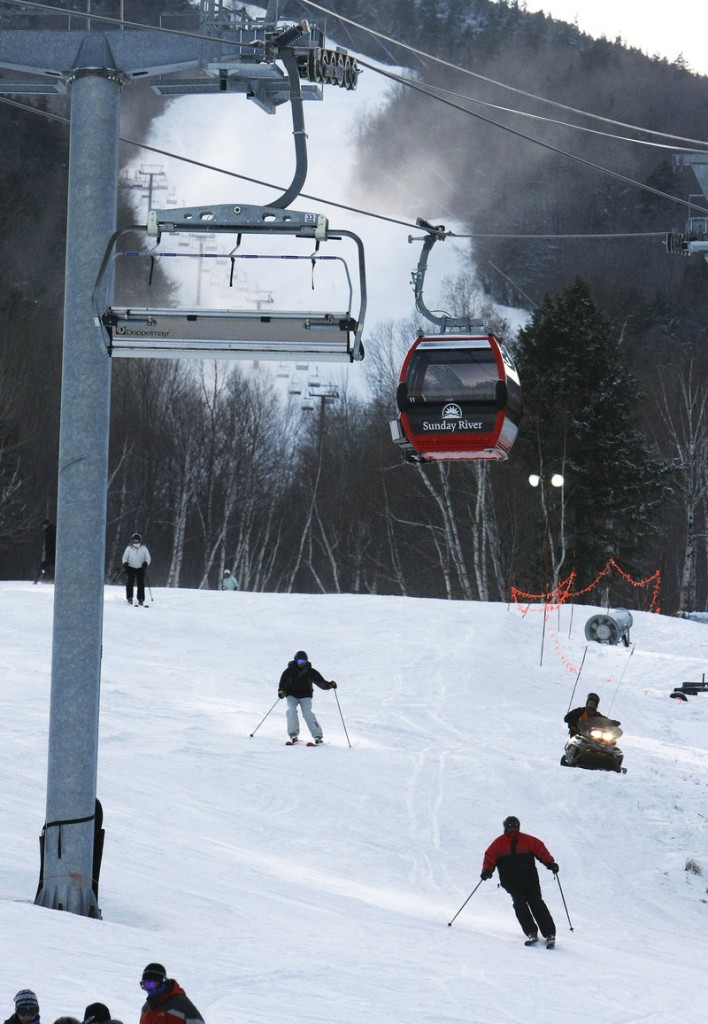 Skiers and riders enjoy an afternoon on the slopes on Saturday at Sunday River in Newry.