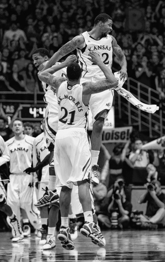 Marcus Morris, right, of Kansas celebrates a 3-point basket with twin Markieff Morris, center, and Thomas Robinson in a game Saturday against USC. The third-ranked Jayhawks pulled out a 70-68 victory.