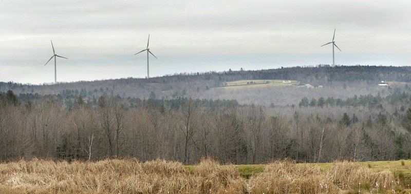 Turbines tower over Beaver Ridge in Freedom. Whether Mainers embrace wind farms in their backyards or not, the Wind Energy Act of 2008 is facilitating development.