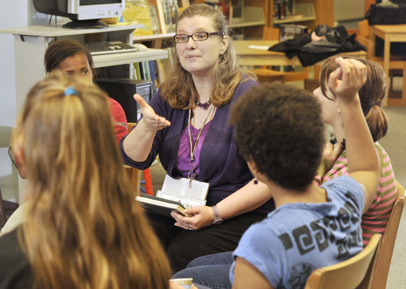 Kelly McDaniel, the librarian at King Middle School, leads a Socratic book circle with sixth-, seventh- and eighth-graders. She was one of 10 librarians nationwide to receive a 2010 I Love My Librarian Award.
