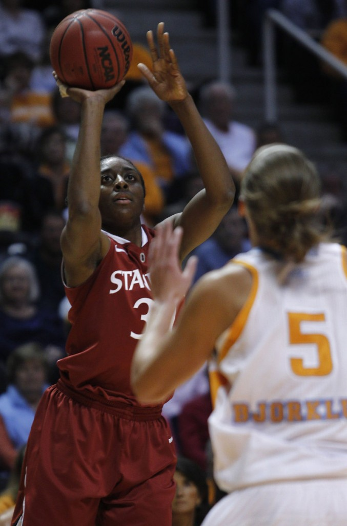 Stanford's Nnemkadi Ogwumike shoots over Tennessee's Angie Bjorklund on Sunday in Knoxville, Tenn. The No. 6 Volunteers knocked off the No. 3 Cardinal 82-72 in overtime.