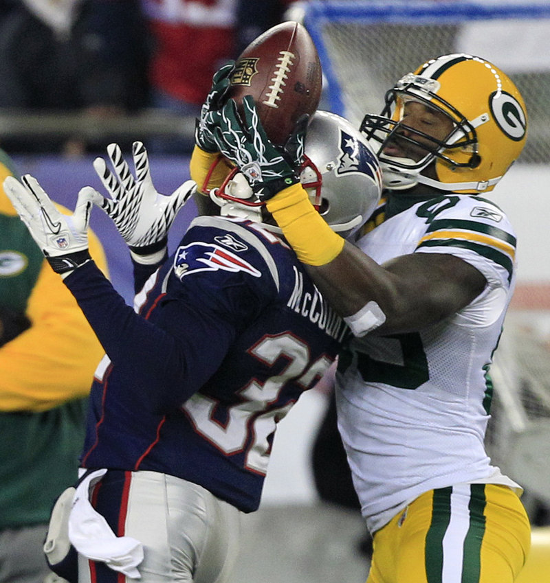 New England cornerback Devin McCourty, left, breaks up a pass intended for Packers receiver James Jones in the first half. Jones had 5 catches for 95 yards, including a 66-yard TD catch in the second quarter for a 10-7 lead.