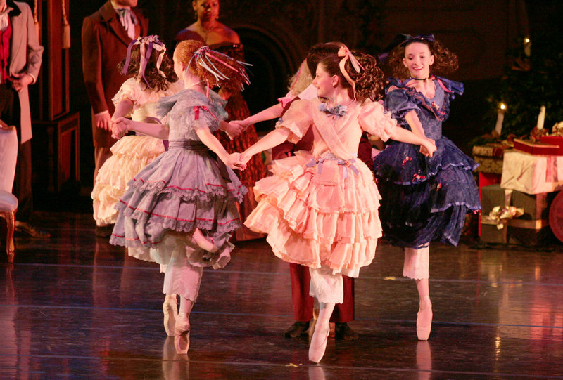 "Party Girls whirl in ""The Victorian Nutcracker."""
