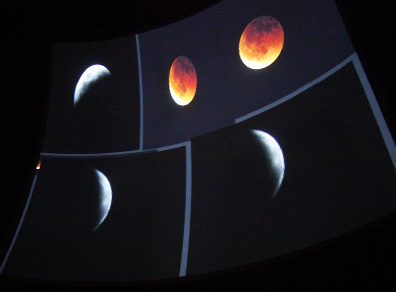 The evening included slides showing different phases of a lunar eclipse. The planetarium had hoped to host a viewing of that night's full lunar eclipse from about 12:45 a.m. to 4 a.m., but it was nixed because of expected cloud cover.