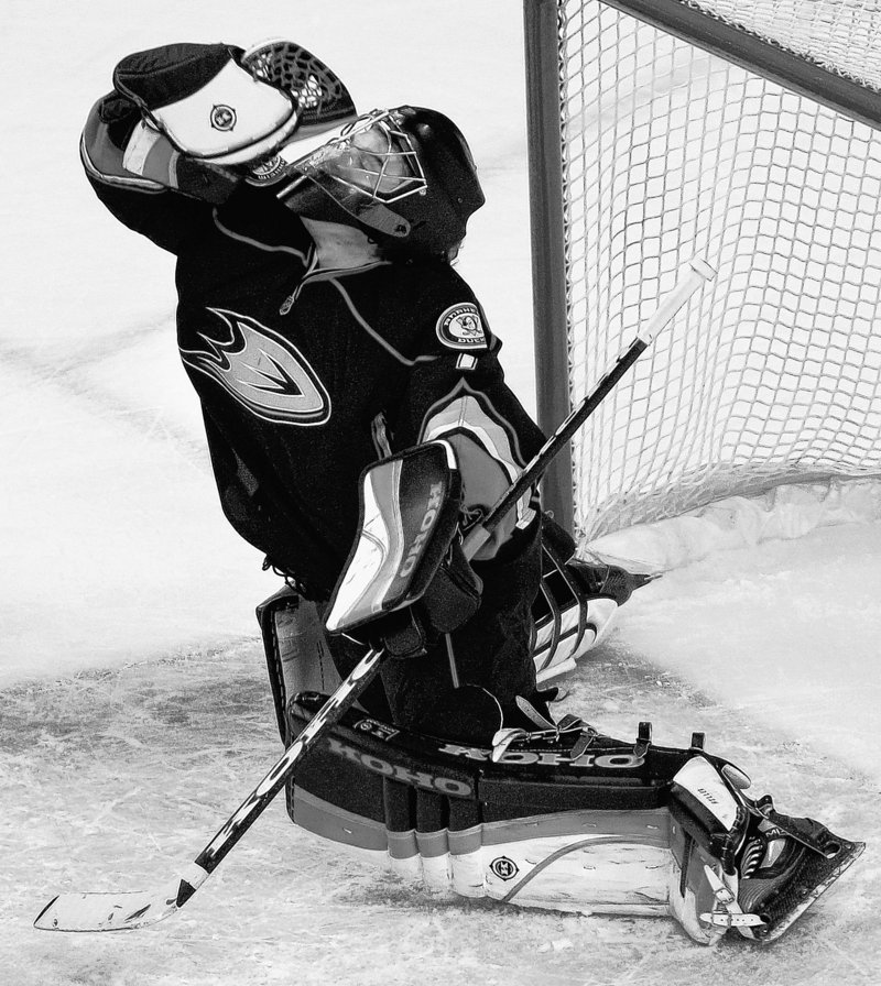 Anaheim goalie Jonas Hiller makes one of his 45 saves against the Bruins on the way to the eighth shutout of his career, handing Boston its fourth loss in five games.