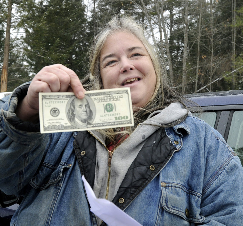 Patricia Ange at the Warming Hut in Sebago, with the contents of her envelope from Secret Santa.